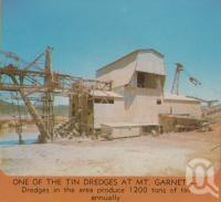 "<span class=""caption-caption"">One of the tin dredges at Mount Garnet</span>. <br />From <span class=""caption-book"">Tropical Atherton Tableland</span>, <span class=""caption-creator"">Tableland Tourist Association</span>, c1970, collection of <span class=""caption-contributor"">Centre for the Government of Queensland</span>."