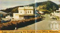 "<span class=""caption-caption"">Sugar cane passing Douglas Shire Office, Mossman</span>. <br />From <span class=""caption-book"">The Douglas Shire</span>, <span class=""caption-creator"">The Douglas Shire</span>, c1958, collection of <span class=""caption-contributor"">Centre for the Government of Queensland</span>."
