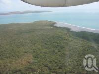 "<span class=""caption-caption"">Horn Island from the air</span>, 2009. <br />Digital image, collection of <span class=""caption-contributor"">Centre for the Government of Queensland MS</span>."