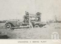 "<span class=""caption-caption"">Unloading a bore plant, Tobermorey Station, Urandangie</span>, 1939. <br />Newspaper, collection of <span class=""caption-contributor"">John Young</span>."