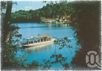 "<span class=""caption-caption"">A glimpse of the lake featuring the cruise boat ""MV Lake Barrine Too"", Lake Barrine, Atherton Tableland</span>, c1970-2000. <br />Postcard, collection of <span class=""caption-contributor"">Murray Views Collection</span>."