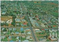 "<span class=""caption-caption"">Aerial view of Chinchilla showing tree-lined main street</span>, c1970-2000. <br />Postcard, collection of <span class=""caption-contributor"">Murray Views Collection</span>."