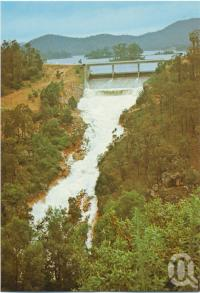 "<span class=""caption-caption"">The Spillway of Perseverance Dam with flood waters tumbling down Perseverance Creek, Crows Nest</span>, c1970-2000. <br />Postcard, collection of <span class=""caption-contributor"">Murray Views Collection</span>."
