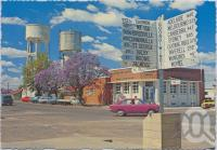 "<span class=""caption-caption"">Sign Post and Water Tower, Goondiwindi</span>, c1970-2000. <br />Postcard, collection of <span class=""caption-contributor"">Murray Views Collection</span>."