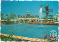 "<span class=""caption-caption"">Looking across the Plaza Fountain to City Hall, Dreamworld, Coomera</span>, c1970-2000. <br />Postcard, collection of <span class=""caption-contributor"">Murray Views Collection</span>."