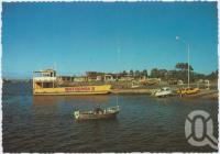 """<span class=""""caption-caption"""">The Urangan Boat Harbour showing the Fraser Island Barge</span>, c1970-2000. <br />Postcard, collection of <span class=""""caption-contributor"""">Murray Views Collection</span>."""