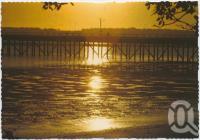 "<span class=""caption-caption"">Sunrise, Urangan Pier</span>, c1970-2000. <br />Postcard, collection of <span class=""caption-contributor"">Murray Views Collection</span>."