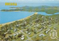 "<span class=""caption-caption"">Aerial view, looking towards Eimeo, Bucasia</span>, c1970-2000. <br />Postcard, collection of <span class=""caption-contributor"">Murray Views Collection</span>."