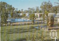 "<span class=""caption-caption"">Features swimming pool, open lawns and a natural sandstone rock from the Moura Open Cut Mine, containing three different pieces of petrified wood, weighing approximately three tonnes, ""Dawson Valley"" Caravan park, Moura</span>, c1970-2000. <br />Postcard, collection of <span class=""caption-contributor"">Murray Views Collection</span>."