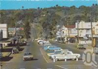 "<span class=""caption-caption"">Looking east along Drayton Street, Nanango</span>, c1970-2000. <br />Postcard, collection of <span class=""caption-contributor"">Murray Views Collection</span>."