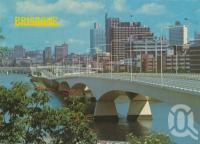"<span class=""caption-caption"">The Captain Cook Bridge and city skyline, Brisbane</span>, c1980. <br />Postcard by <span class=""caption-publisher"">Murray Views Pty Ltd</span>, collection of <span class=""caption-contributor"">Centre for the Government of Queensland</span>."