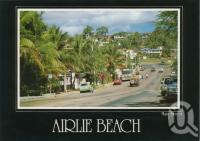 "<span class=""caption-caption"">Main street, Airlie Beach</span>, c1985. <br />Postcard by <span class=""caption-publisher"">Peer Productions</span>, collection of <span class=""caption-contributor"">Centre for the Government of Queensland</span>."