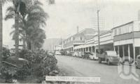 "<span class=""caption-caption"">Main street, Atherton</span>, c1945. <br />Postcard folder by <span class=""caption-publisher"">Murray Views Pty Ltd</span>, collection of <span class=""caption-contributor"">Centre for the Government of Queensland</span>."