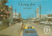 "<span class=""caption-caption"">Queen Street, Ayr</span>, c1975. <br />Postcard by <span class=""caption-publisher"">Murray Views Pty Ltd</span>, collection of <span class=""caption-contributor"">Centre for the Government of Queensland</span>."