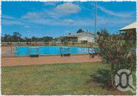 "<span class=""caption-caption"">Swimming Pool with Bowls Clubhouse in background, Yarraman</span>, c1970-2000. <br />Postcard, collection of <span class=""caption-contributor"">Murray Views Collection</span>."