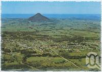 "<span class=""caption-caption"">Aerial view of Cooroy with Cooroy Mountain and the coastline to the east</span>, c1970-2000. <br />Postcard, collection of <span class=""caption-contributor"">Murray Views Collection</span>."