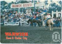"<span class=""caption-caption"">Warwick Rodeo - held the last week-end in October every year, attracts thousands of visitors, Warwick</span>, c1970-2000. <br />Postcard, collection of <span class=""caption-contributor"">Murray Views Collection</span>."